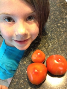 My daughter, Sylvie, with some of my Early Girl tomatoes.