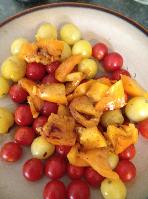Red, yellow and white cherry tomatoes make a colorful salad.